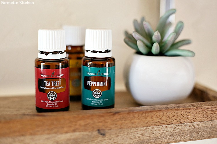 Bottles of Young Living Essential Oils- Tea Tree, Peppermint, and Lemon