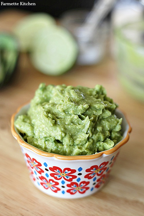 decorative bowl overflowing with a scoop of guacamole