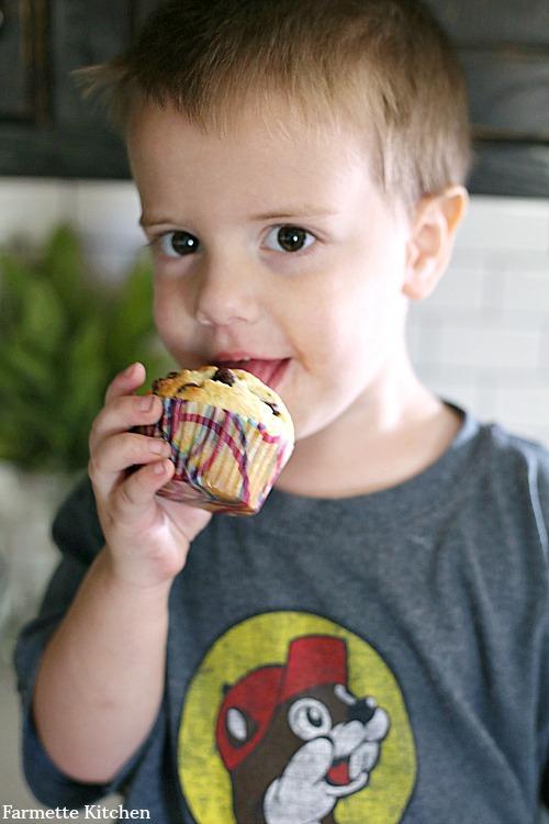 toddler eating muffin