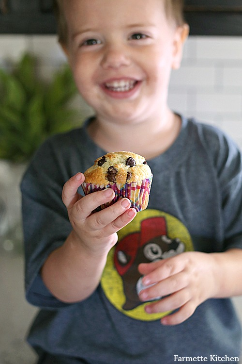 toddler holding small batch chocolate chip muffin