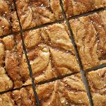 close up of salted caramel blondies cut into uniform squares