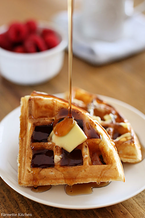 waffle triangles on a plate with butter and syrup