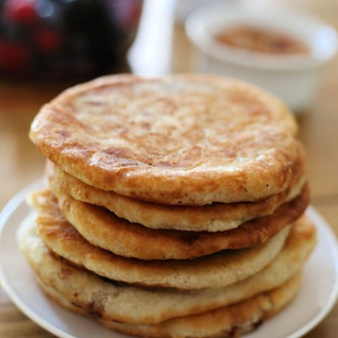 a stack of hotteok Korean pancakes on a plate
