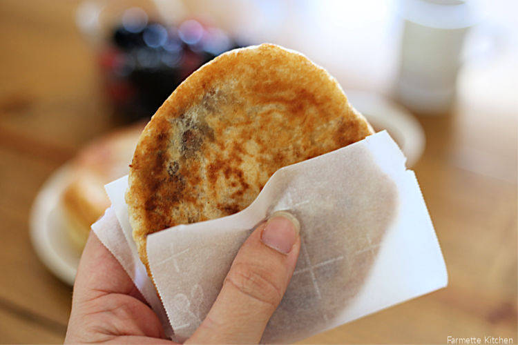 a Korean street food pancake wrapped in parchment paper