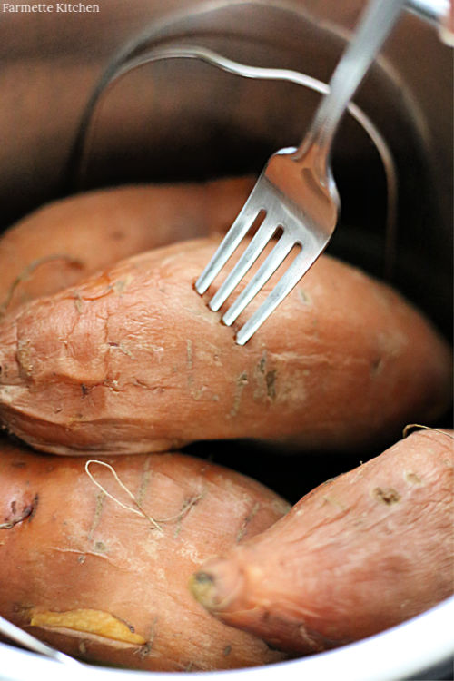 poking a sweet potato with a fork