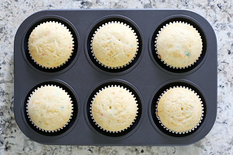 baked vanilla cupcakes in a muffin tin