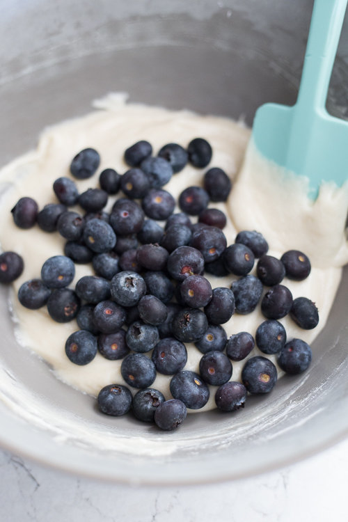 muffin batter with blueberries on top