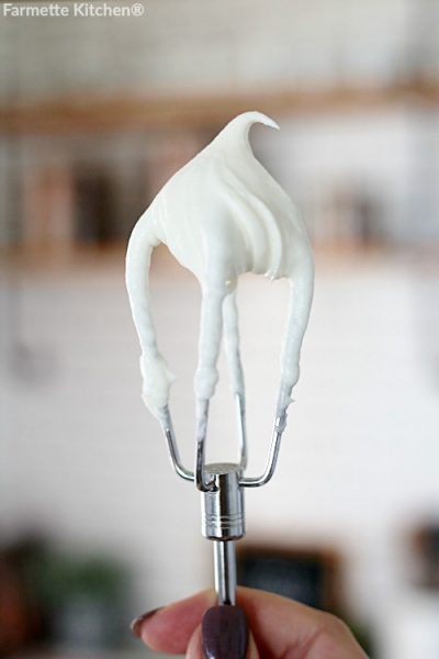 cream cheese frosting on a mixing beater