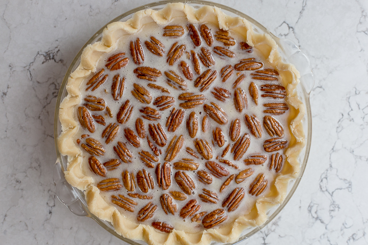 unbaked pecan pie in a dish