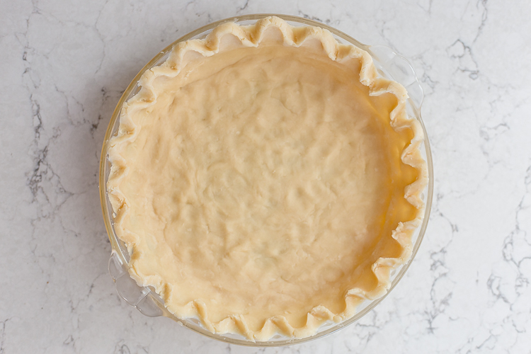 empty homemade pie crust in a dish