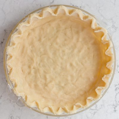 an unbaked all butter pie crust sitting on the counter