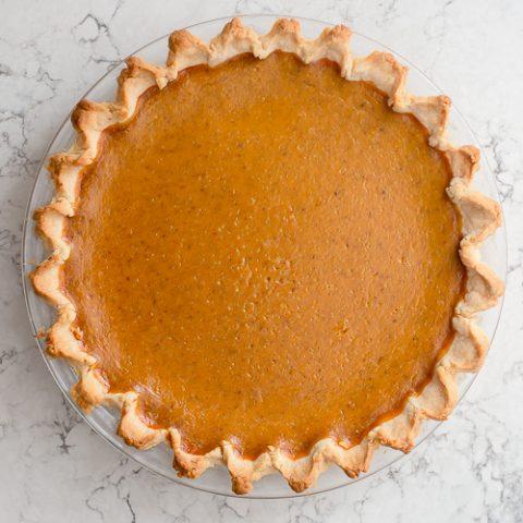 pumpkin pie sitting on the counter