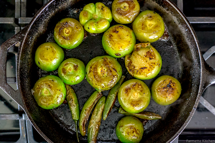 roasted tomatillos in a cast iron skillet
