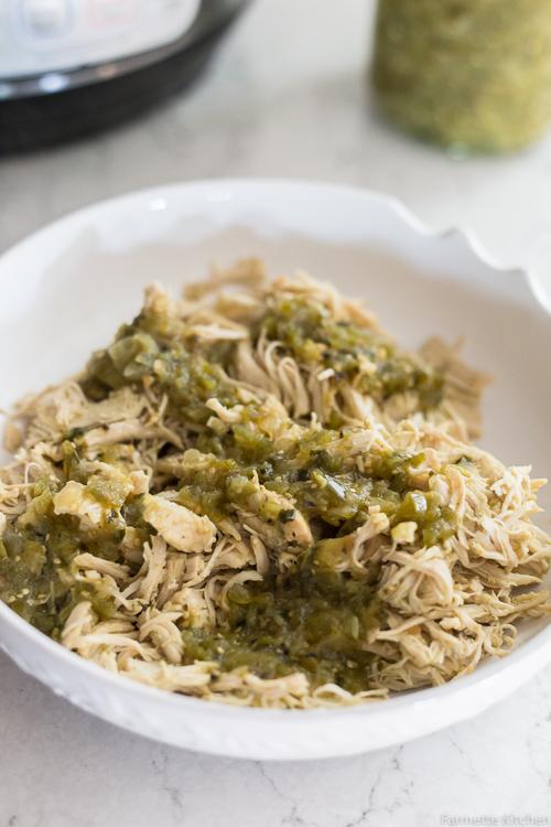 bowl full of shredded salsa verde chicken