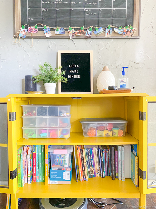 yellow cabinet with homeschool supplies