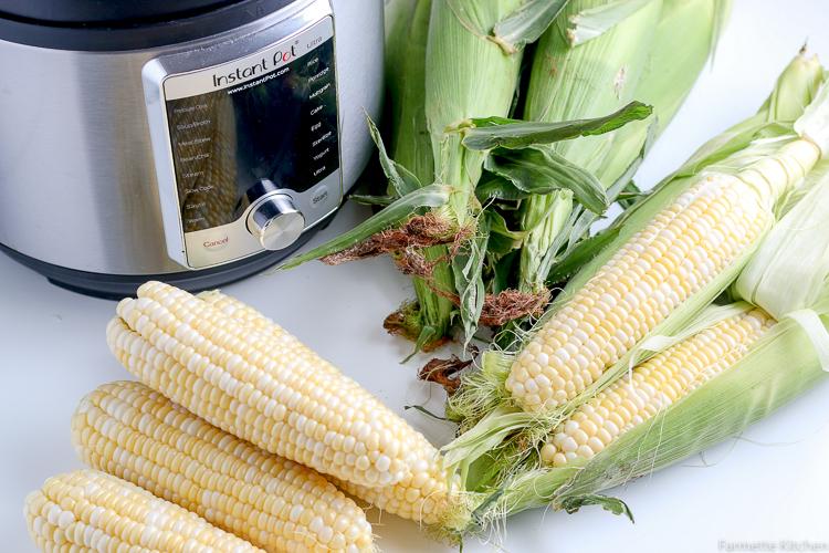 shucked corn next to unshucked corn