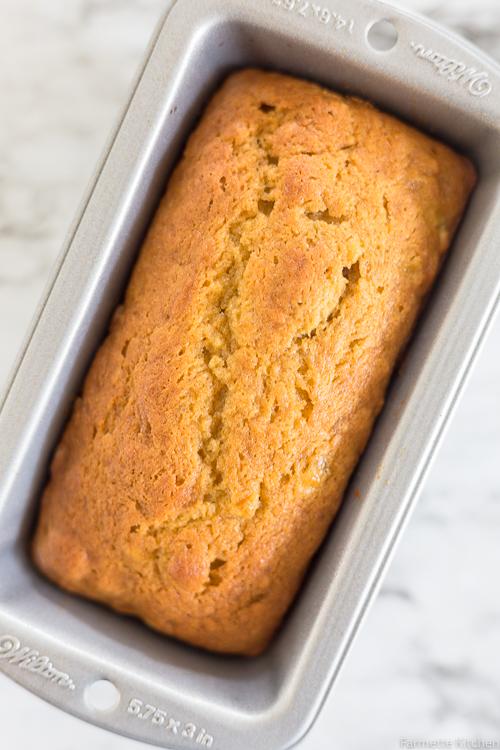 a loaf of mini pumpkin banana bread in a loaf pan