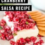 Cranberry salsa made with fresh cranberries, red onion, jalapeño, and cilantro tossed with sweetened lime juice. Serve this super easy dip over softened cream cheese and watch it disappear!