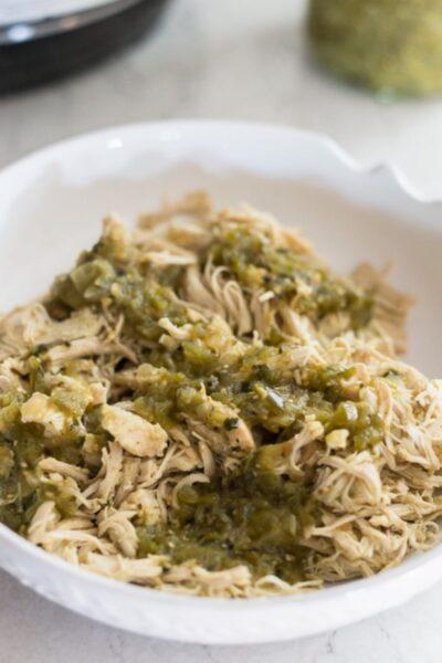 shredded chicken with salsa verde salsa in a bowl