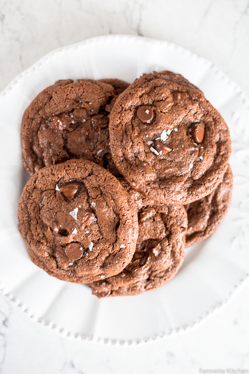 pile of double chocolate cookies on a white plate