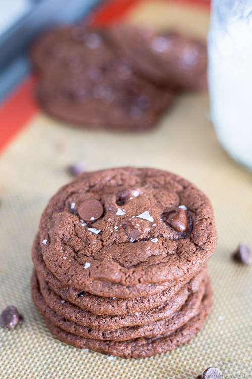 stack of double chocolate cookies on a baking sheet