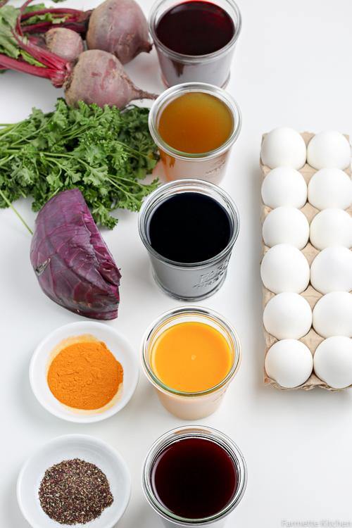 bowls of dye beside a dozen eggs