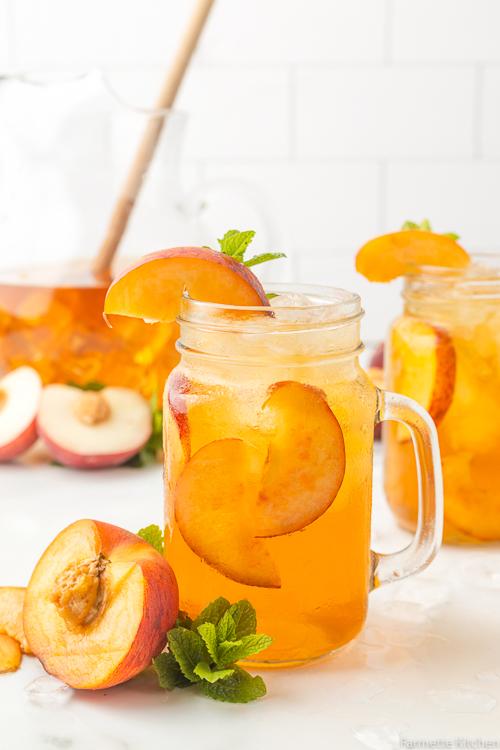 peach tea next to a halved peach