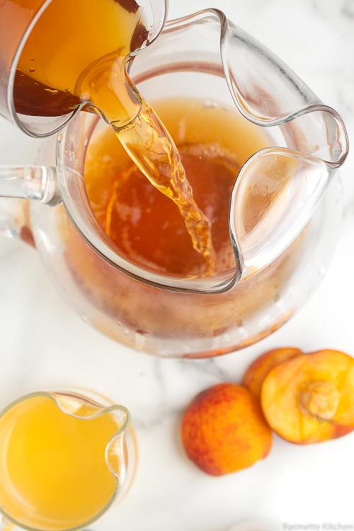 pouring tea into a glass
